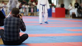Photographers shoot during a karate competitions stock images