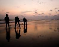 Photographers shoot photo of the sunset Royalty Free Stock Image