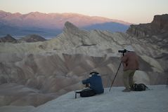 Photographers shoot sunrise in Death Valley, CA stock images