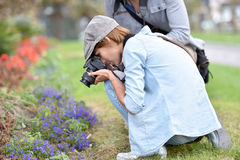 Photographers shooting macro Stock Images