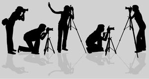 Photographers shooting model Royalty Free Stock Image