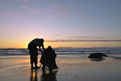 Photographers in silhouette. In the beach in sunset ot sunrise Royalty Free Stock Photos