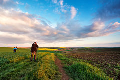 Photographers on spring green fields of Czech Moravia. Travel an. D active lifestyle. Sunset at rural spring landscape Stock Photos