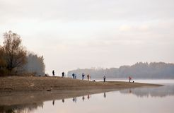 Photographers taking photos of beautiful river landscape in the morning Royalty Free Stock Image