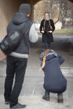 Photographers work with a model on the street Stock Image