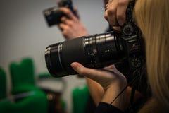 Photographes au travail Photos stock