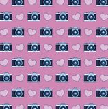 Photographic camera and hearts background Stock Image