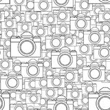 Photographic camera seamless pattern. Seamless pattern of the photographic dslr cameras Royalty Free Stock Image