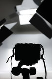 Photographic equipment setup. Black and white still life of a photographic equipment setup. Focus on silhouetted camera in the foreground royalty free stock photos