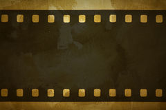 Photographic film. On the grung background Royalty Free Stock Images