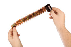 Photographic film in hands Stock Images
