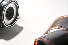 Photographic film and old camera Royalty Free Stock Images