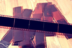 Photographic film on wooden background. Stock Photos