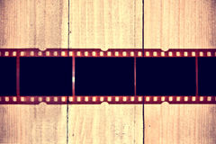 Photographic film on wooden background. Royalty Free Stock Photos