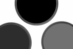 Photographic filters. Photographic camera equipment filter on white seamless background Royalty Free Stock Photos