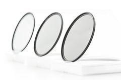 Photographic filters. Photographic camera equipment filter on white seamless background Royalty Free Stock Photography