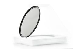 Photographic filters. Photographic camera equipment filter on white seamless background Royalty Free Stock Photo