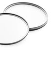 Photographic filters. Photographic camera equipment filter on white seamless background Stock Photos