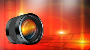 Photographic lens on abstract red background Stock Photos