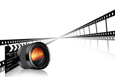 Photographic lens clap board and film strip Stock Images