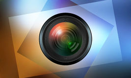 Photographic lens on color background Royalty Free Stock Photos
