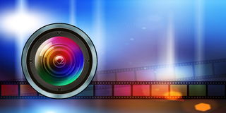 Photographic lens and film strip on abstract background Royalty Free Stock Photo