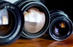 Photographic lenses on the red table Stock Images