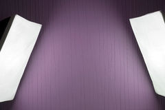 Photographic LIghting - Two Studio Lights with Soft Boxes on Tripods. With purple background stock photo