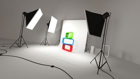 Photographic studio. Bright lights in photographic studio lighting colorful objects on white background Stock Images