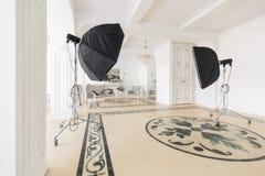 Photographic studio with modern lighting equipment. Light spring room studio interior. Luxury decor with daylight. Stock Images