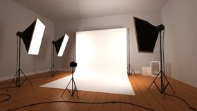 Photographic studio. A modern photographic studio with wooden floor set up for a photoshoot Stock Images