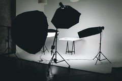 Photographic studio. Photo of an empty photographic studio with modern lighting equipment. Empty space for your text or objects Royalty Free Stock Images