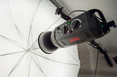 Photographic studio strobe lighting and reflective umbrella Stock Photos