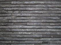 Photographie en pierre grise mince posée de fond de brique Images stock