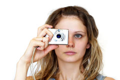 Photographing. Young woman digital camera photographing over white background Royalty Free Stock Photos