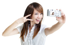 Photographing. Asian girl self photographing, isolated on white Stock Photography