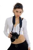 Photographing. Attractive girl with camera against white background Royalty Free Stock Images