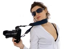Photographing. Attractive girl with camera against white background Stock Image