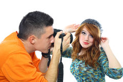 Photographing beautiful girls. Photographing the beautiful red-haired girl isolated on white Stock Photos