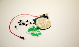 Photographing bitcoin, arduino, transistors and wires. On white background Stock Photography