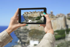 Photographing Bonifacio with tablet Royalty Free Stock Images