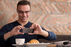 Photographing breakfast Royalty Free Stock Images