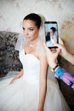 Photographing the bride on smartphone. In wedding morning Royalty Free Stock Image