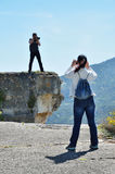 Photographing on the cliff Stock Photo