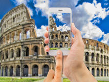 Photographing the Coliseum with my phone Royalty Free Stock Photos
