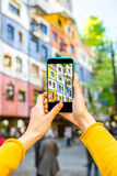 Photographing colorful building facade. Photographing with smart phone colorful building facade in Vienna royalty free stock image