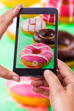 Photographing colorful donuts Stock Photos