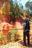 Photographing the colorful ochre rocks, Roussillon, France Royalty Free Stock Images