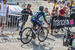 Photographing the Cyclists. Mont Ventoux, France- July 14 2013: The Colombian cyclist Nairo Alexander Quintana Rojas (Movistar Team), climbing the last kilometer royalty free stock image