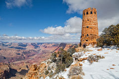Photographing Desert View Watchtower in Winter. A photographer next to the historic desert view watchtower stands guard over the amazing colorful scenery of the Royalty Free Stock Image